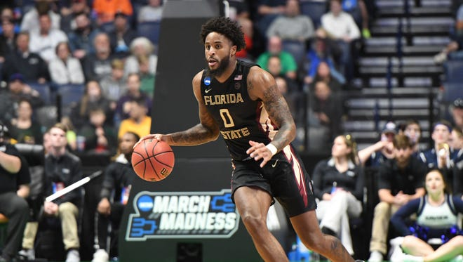 FSU senior forward Phil Cofer leading the fast break during the first half in FSU's 75-70 victory over Xavier.
