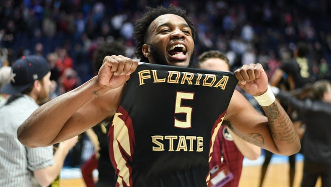 FSU junior guard PJ Savoy celebrating after upsetting 1st seed Xavier.