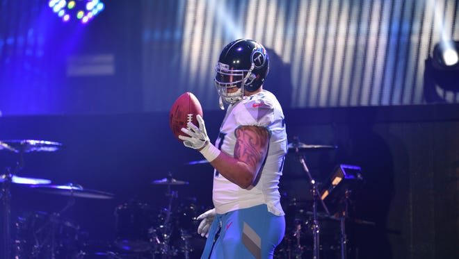 Tennessee Titans tackle Taylor Lewan in the new uniforms unveiled Wednesday.