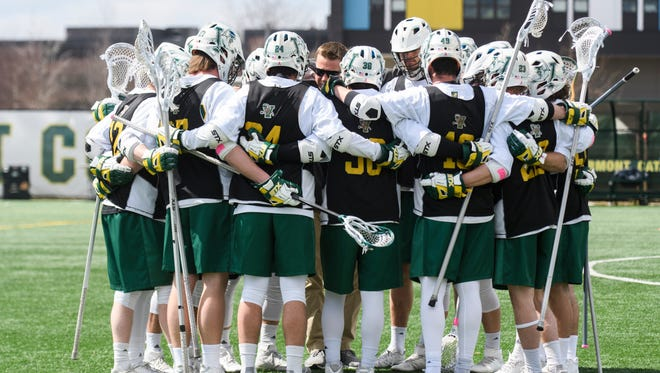 Vermont huddles together during warm ups before the start of the men's lacrosse game between there UMass Lowell Riverhawks and the Vermont Catamounts at Virtue Field on Saturday afternoon April 7, 2018 in Burlington. (BRIAN JENKINS/for the FREE PRESS)