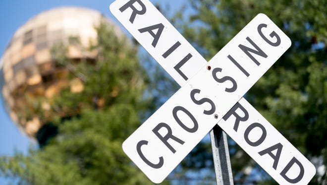 A railroad crossing at the rail line running through World's Fair Park in Knoxville, Tennessee on Tuesday, April 10, 2018. Former Knoxville City Councilman Joe Hultquist is leading a charge to bring a light rail service from downtown Knoxville to McGhee Tyson Airport.
