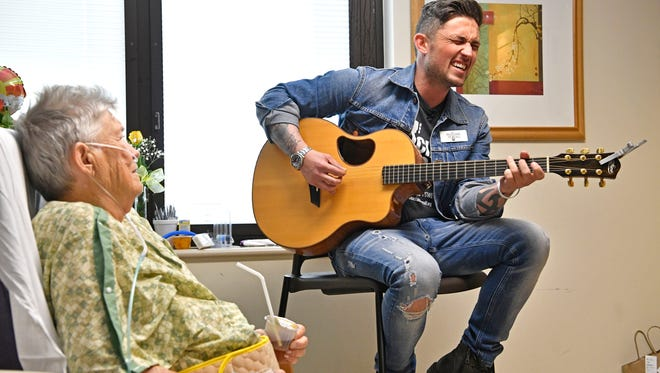 At her bedside Mary Haupt gets a private performance by Michael Ray as he helped Musicians on Call launch a new ongoing Beside Performance Program at Sunrise Hospital and Medical Center, where many of the Route 91 victims were treated.  Friday April 13, 2018, in Las Vegas, NV