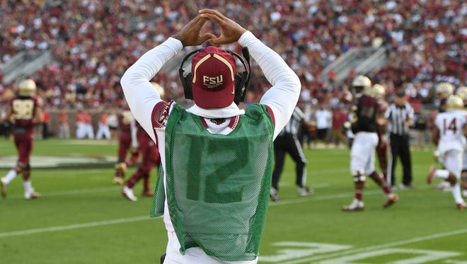 FSU redshirt junior quarterback Deondre Francois is still healing from a last season injury and helped out on the sideline on Saturday evening at the FSU spring game.