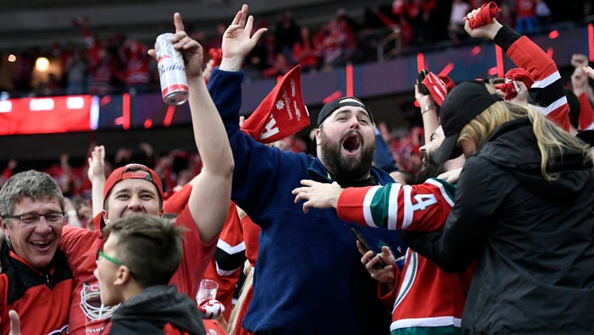 Fans react as the Devils make an empty net goal in the third period, pushing the lead to 4-2. The Devils defeat the Lightning 5-2 in Game 3 of Round 1 of the Stanley Cup Playoffs at the Prudential Center in Newark, NJ on Monday, April 16, 2018. The series is 2-1, Tampa Bay.
