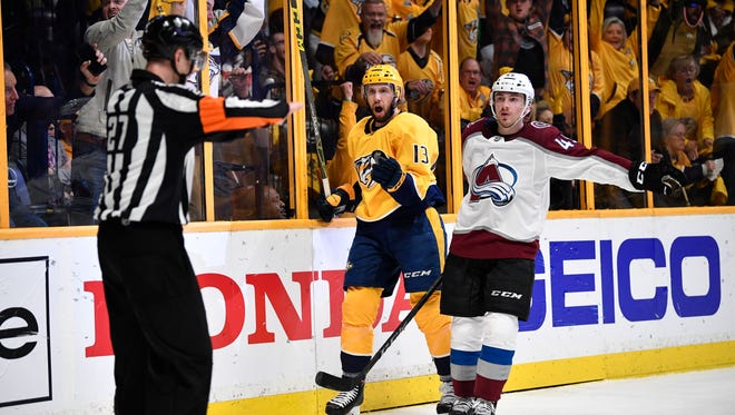 Nashville Predators center Nick Bonino (13) reacts to the initial call of no-goal which was overturned for the team's first goal during the third period in game 5 of the first round NHL Stanley Cup Playoffs at the Bridgestone Arena Friday, April 20, 2018, in Nashville, Tenn.