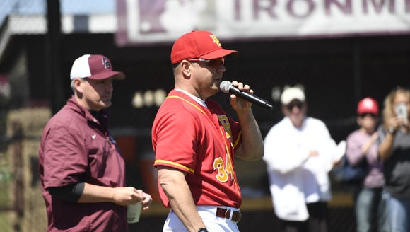 Bergen Catholic baseball head coach Bob Muggeo, right,