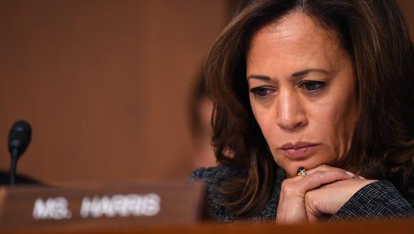 Sen. Kamala Harris, D-Calif., asking questions as Gina