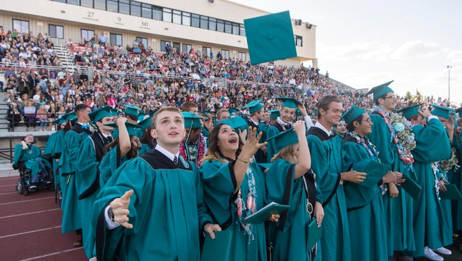 Canyon View High School seniors participate in their graduation ceremony in Eccles Coliseum Wednesday, May 23, 2018.