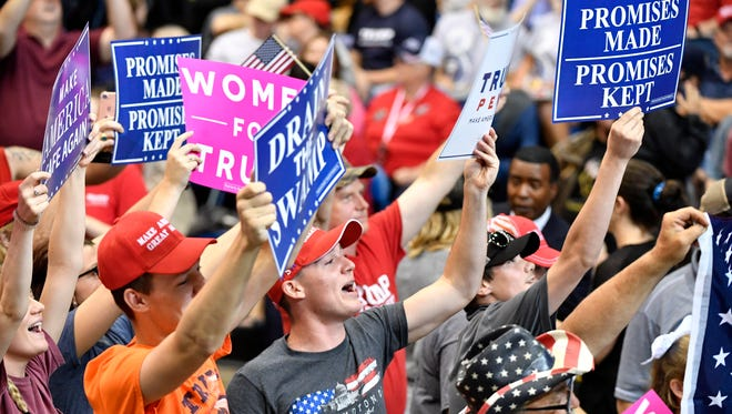 Supporters hold signs before the rally by President Donald Trump at Municipal Auditorium, Tuesday, May 29, 2018, in Nashville, Tenn.