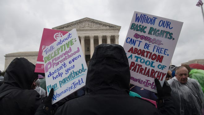 Anti-abortion activists demonstrated in front of the Supreme Court in March as the justices heard a case from California. On Tuesday, they refused to block abortion restrictions in Arkansas pending further review by lower courts.