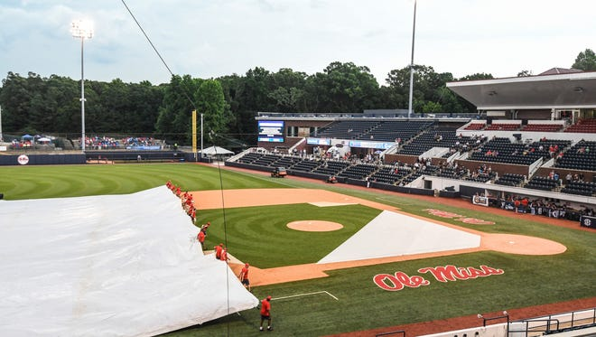 The grounds crew puts the tarp on the field during a weather delay before the start of the Missouri State against Tennessee Tech game at Oxford-University Stadium for the NCAA Oxford Regional, in Oxford, Miss. on Friday, June 1, 2018. (Bruce Newman, Oxford Eagle via AP)