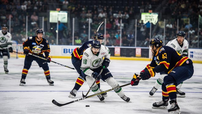 Spencer Smallman dodges an Eagles defender during game 5 of the Kelly Cup Finals against the Colorado Eagles at Germain Arena on Saturday, June 2, 2018.
