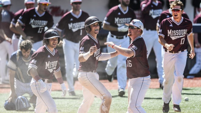 Missouri State catcher Drew Millas (24) and Missouri State pitcher Jake Fromson (16) celebrate the win over St. Louis in the NCAA Oxford Regional, at Oxford-University Stadium in Oxford, Miss. on Sunday, June 3, 2018. Missouri State won 9-8 on a walk off. (Bruce Newman, Oxford Eagle via AP)