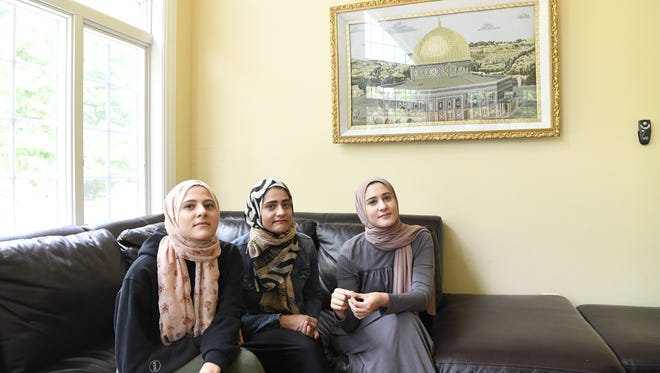 Yasmine Elfarra, 21, left, and her sisters Suzanne, 23, and Sarah, 19, at their home in Wayne. They are among 14 women who have filed a complaint against the Transportation Security Administration alleging that they were the victims of anti-Muslim bias at Newark Liberty International Airport in December.