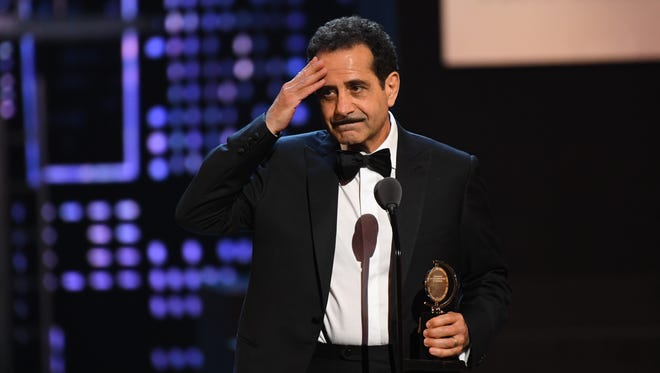 """Tony Shalhoub accepts the award for best performance by an actor in a leading role in a musical for """"The Band's Visit"""" at the 72nd Tony Awards."""