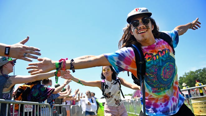 Jordan Hargett of New Orleans greets other fans at the Bonnaroo Music & Arts Festival in Manchester, Tenn., on June 7, 2018.