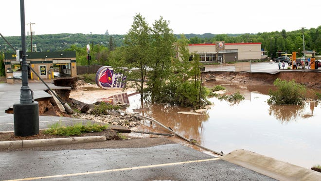 A Taco Bell drive-through caved in and washed away after heavy rains and flooding in Houghton, Mich. on June 17, 2018. Widespread flooding in the Upper Midwest was blamed for at least one death in Wisconsin, while officials in northern Michigan were assessing damage from flash-flooding that washed out roads, damaged businesses and created dozens of sinkholes.