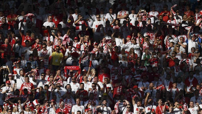 Fans cheer their team prior to the World Cup match between Poland and Senegal at the Spartak Stadium in Moscow on June 19.