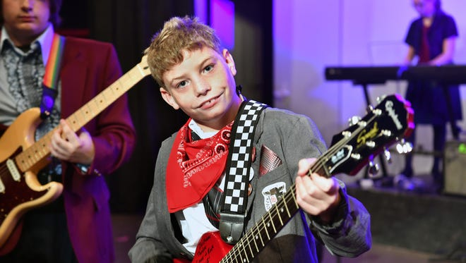 Special needs superfan Nolan Lee, 13, was presented with an electric guitar and case autographed by the cast of the musical School of Rock Friday afternoon.