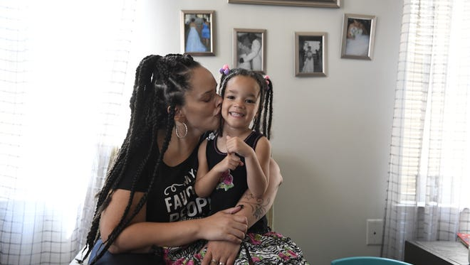 """Jennifer Torres and her daughter Dominique, 4, in their home in Camden. Torres has joined a lawsuit challenging New Jersey and the state Board of Education to take steps to end """"de facto"""" segregation in the state's public schools."""