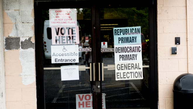 """Vote Here"" signs at The Love Kitchen during early voting in Knoxville, Tennessee on Tuesday, July 17, 2018."