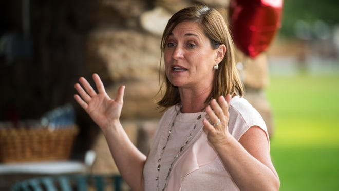 Democratic U.S. Senate candidate Jenny Wilson says her GOP rival Mitt Romney is out of touch on immigration.