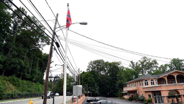 A Confederate battle flag rears its ugly head above the former Paris Inn in Wayne