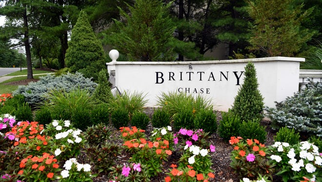 The entrance to Brittany Chase, a complex of 395 condominiums and town houses, off Berdan Avenue in Wayne.