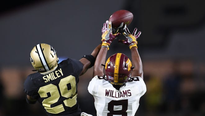 Simeon Smiley #29 of the Purdue Boilermakers breaks up a pass intended for Mark Williams #8 of the Minnesota Golden Gophers. Smiley declared for the NFL Draft on Thursday.