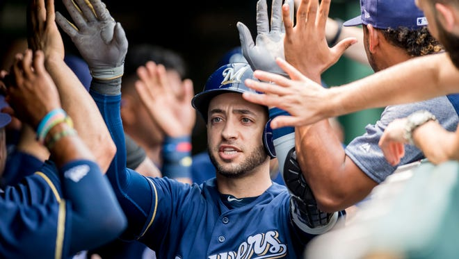 Aug 14, 2018; Chicago, IL, USA; Milwaukee Brewers left fielder Ryan Braun (8) celebrates his two run home run during the first inning against the Chicago Cubs at Wrigley Field. Mandatory Credit: Patrick Gorski-USA TODAY Sports