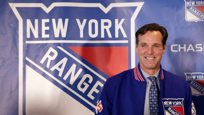 The New York Rangers new head coach David Quinn poses during an NHL hockey news conference in New York, Thursday, May 24, 2018.