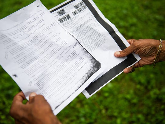 Theo Mitchell holds copies of the restrictive deed for his home near Cleveland Park on Thursday, June 28, 2018.