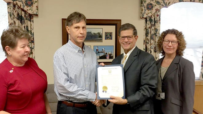 Kevin Anspach, second from left, an administrative case manager for the Lebanon County Area Agency on Aging, receives a proclamation Thursday, Oct. 20, from Lebanon County Commissioner Bob Phillips on his retirement after 35 years with the county. Standing with them are Commissioner Jo Ellen Litz, left, and Area Agency on Aging Director Carol Davies.