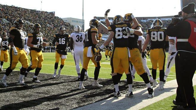 Iowa teammates celebrate after Matt VandeBerg's touchdown against Purdue on Nov. 21.