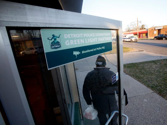 A customer walks out of Southern Smokehouse on West McNichols Road in Detroit, Michigan, on Thursday, April 19, 2018. This carryout BBQ restaurant participates in the Detroit Police Green Light program. This restaurant has four cameras that are connected to the Detroit Police.