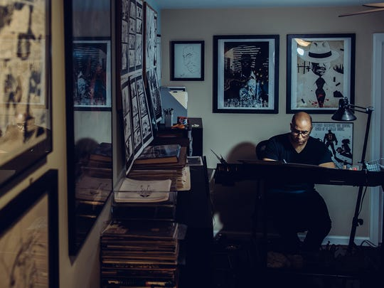 Comic book artist Shawn Martinbrough is seen here working on a comic in his home office.