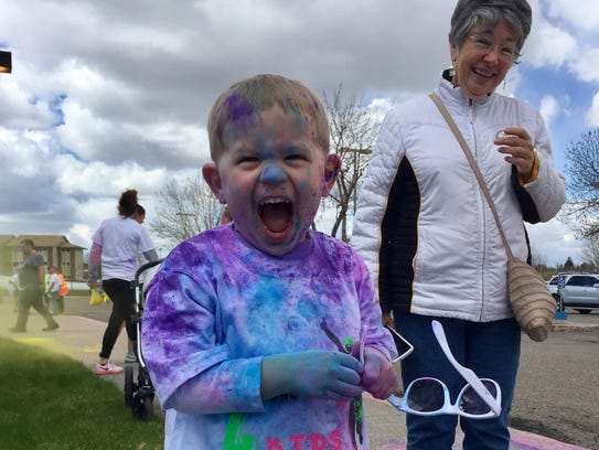 Zeke Brody, 4, squeals in delight at the Kolor Me 4