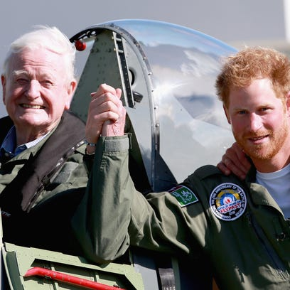 Harry poses with retired RAF pilot Tom Neil, 95, a