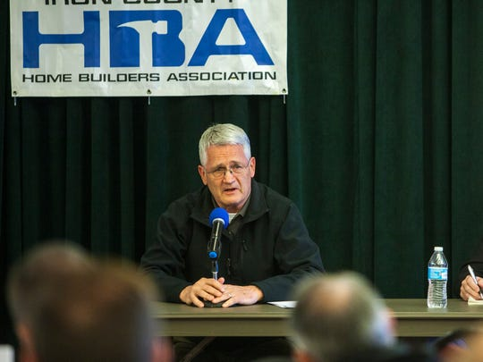 State Rep. John Westwood (left) speaks at the Iron