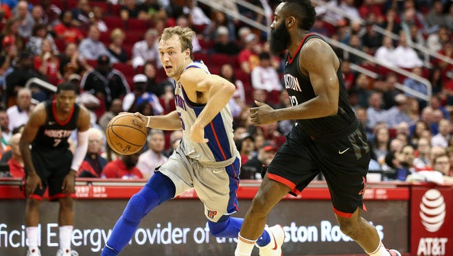 Pistons guard Luke Kennard (5) drives with the ball as Rockets guard James Harden (13) defends during the fourth quarter of the Pistons' 100-96 overtime loss on Thursday, March 22, 2018, in Houston.