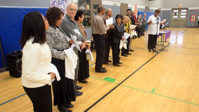 Members of the University of Iowa community receive awards during the Martin Luther King, Jr. Bell Ringing and Candle Lighting Award Ceremony at Grant Wood Elementary Monday, Jan. 19, 2015.