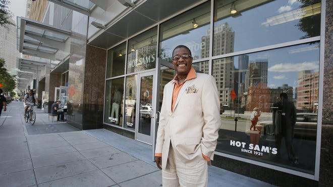 Tony Stovall owner of Hot Sam's clothing store in front of his store at 127 Monroe street in Detroit on Tuesday, July 21.