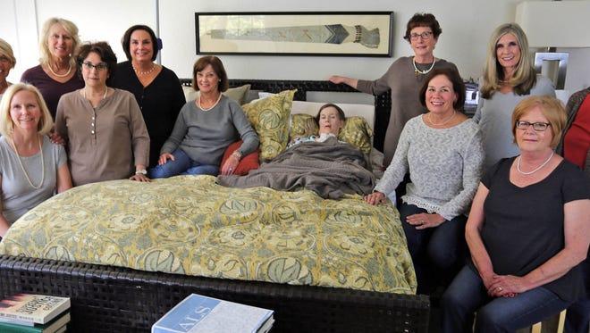 From left: Suzie Warmus, Sandy Sachse, Mary Jo Vollrath, TC McCarty, Sally Nead, Laura Bentelt, Wendy Rauwerdink (who has ALS), Margaret Hand, Marion Helf, Tootie Richter, Kiki Suschsa and Bobbie Kussard.