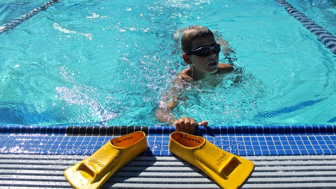 Tommy Ansley, 10, finishes a lap during a swimming practice session at the Palm Desert Aquatic Center in September 2015.