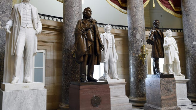 In this June 24, 2015, file photo, a statue of Jefferson Davis, second from left, president of the Confederate States from 1861 to 1865, is on display in Statuary Hall on Capitol Hill in Washington. House Speaker Nancy Pelosi is demanding that statues of Confederate figures such as Jefferson Davis be removed from the U.S. Capitol.