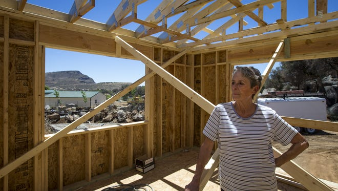 Nina Bill Overmyer is proud of the house she and her husband rebuilt on the same site in Glen Ilah, near Yarnell, after the 2013 Yarnell Hill Fire. She is pictured on Thursday, June 19, 2014.