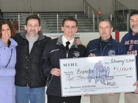 From left to right during the MIHL David Mannino Scholarship presentation last month are Barb Olepa, Ed Olepa, Plymouth goalie Brendan Olepa, MIHL president Andy Weidenbach and Dr. Thomas Mannino (David's father). Brendan Olepa received $2,000 which he will use toward the first year of college at Grand Valley State University.