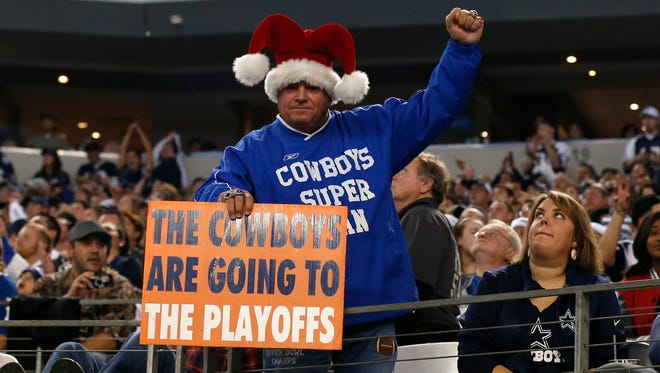 Dallas Cowboys fan holds a sign that the Cowboys are going to the playoffs against the Indianapolis Colts at AT&T Stadium. Mandatory Credit: Matthew Emmons-USA TODAY Sports ORG XMIT: USATSI-180486 ORIG FILE ID:  20141121_mje_se2_383.jpg