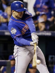 New York Mets' David Wright hits a single during the seventh inning of Game 1 of the Major League Baseball World Series against the Kansas City Royals Tuesday, Oct. 27, 2015, in Kansas City, Mo. (AP Photo/David J. Phillip)