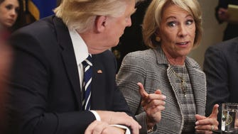 Education Secretary Betsy DeVos and President Trump on Feb. 14, 2017.